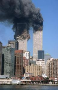 ** FOR USE AS DESIRED WITH SEPT. 11 ANNIVERSARY STORIES--FILE **The south tower begins to collapse as smoke billows from both towers of the World Trade Center, in New York, in this Sept. 11, 2001, file photo. In one of the most horrifying attacks ever against the United States, terrorists crashed two airliners into the World Trade Center in a deadly series of blows that brought down the twin 110-story towers. This year will mark the fifth anniversary of the attacks. (AP Photo/Jim Collins/FILE)